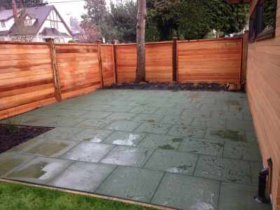 A backyard patio constructed from eco-friendly recycled rubber tiles